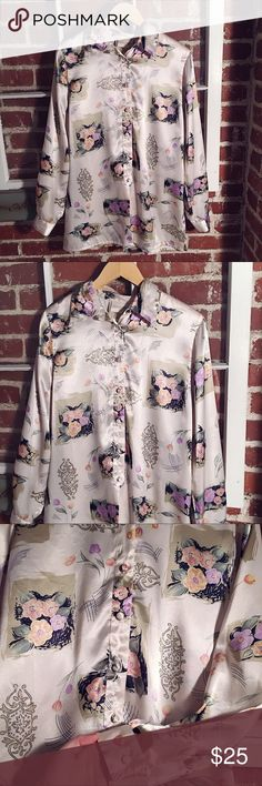 🌷Vintage Floral Blouse🌷 This vintage blouse is silky and dreamy! LOVE the floral pattern and buttons. Fits like a M/L.  Great with flare jeans or tied up at waist🌷✨🌈 Vintage Tops Blouses