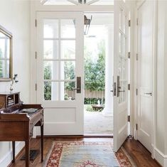 Double doors let in light.  compact entry, but enough room to stand and talk. Move coat closet away from door.