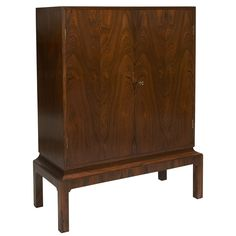 Exquisitely crafted Danish rosewood cabinet on stand | From a unique collection of antique and modern cabinets at http://www.1stdibs.com/furniture/storage-case-pieces/cabinets/