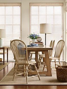 Dining table by Barbara Barry. Chairs by Richard Mulligan. Visual Comfort floor lamps by Barry. David Meredith  - Veranda.com