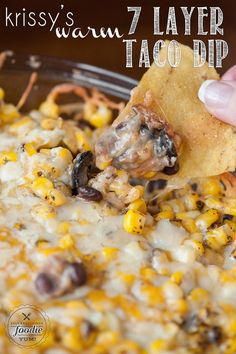 Krissy's Warm 7 Layer Taco Dip has all the delicious ingredients you'll find in your favorite taco and makes a perfect family dinner or game day grub. {Self Proclaimed Foodie}