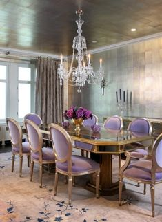 Purple chairs and silver walls & ceiling