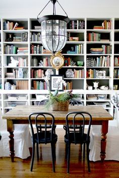 Dining room with built-in bookshelves @emilyaclark