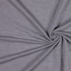 This is a light weight, soft handed, rayon jersey with stretch.