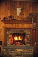 A raised hearth is a warm, cozy place to sit on a cold night.