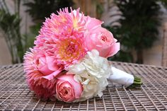 White Hydrangea, Coral Dahlia's and Pink Garden roses.  What a fabulous Bridal Bouquet designed by Eastern Floral.