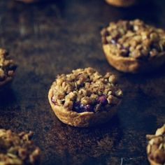 Cranberry mini pies topped with walnut streusel.