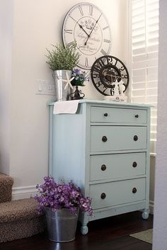 We store our dvd's in a dresser almost exactly like this, except it's painted white-ish-sort-of.  Hmmm.  Blue :)