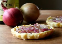 Alsatian Onion Tart Recipe -  Pastry Crust 9 ounces flour 4 ounces unsalted butter, cut into cubes 2 egg yolks 1 pinch salt (generous) 3 -4 tablespoons ice cold water Tart Ingredients 4 tablespoons olive oil 1 lb onion, chopped 1 bay leaf 1⁄2 teaspoon thyme salt and pepper 5 ounces alsatian wine 2 eggs 7 ounces single cream (light)