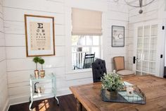 The second office space has a more feminine feel with white shiplap and large French doors.