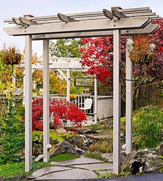 Entry Pergola  Create a grand entry to an outdoor space using a pergola. This gray-stained structure marks the entrance to a garden from the driveway.