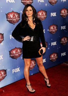 Sara Evans in a black mini dress.