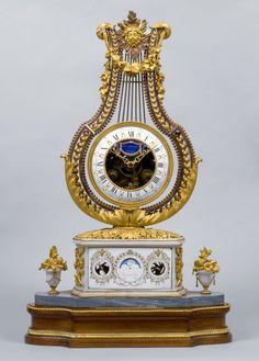 A Louis XVI lyre clock by Jacques-Thomas Bréant, enamel work by Joseph Coteau