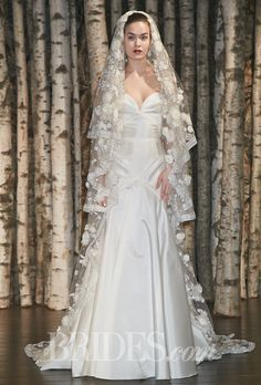 """Brides.com: Exclusive: Whitney Port's 10 Favorite Looks from Bridal Fashion Week. Naeem Khan. """"I've also been toying with the idea of wearing a veil, and this one makes me feel like I want one,"""" she reveals. """"It's such a beautiful, intricate accessory, especially if you have a very simple dress.""""  """"Amalfi"""" strapless silk trumpet wedding dress with a sweetheart neckline, Naeem Khan"""