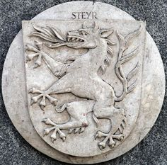 Steyr Coat of Arms Stone Plaque in Linz (Austria) -- photo by Lawrence Chard