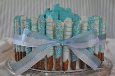 I think I could do that!: Blue Baby Boy Shower Cake ~ Love the pretzels for favors!