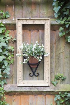 , Article: Small garden ideas - how to add character and drama to your small garden. Fun, DIY tips and container planting inspiration. , 11 charming small garden ideas on a budget Small Garden Window, Garden Windows, Backyard Garden Design, Small Garden Design, Garden Art, Rustic Backyard, Big Garden, Garden Beds, Garden Types
