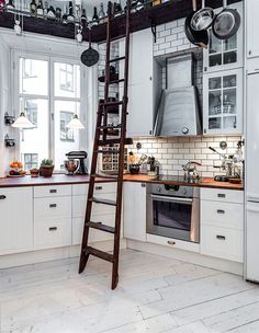 White Tile Back Splash with Wood Accents and a Bar above all!! | Kitchen Inspiration