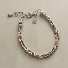 A three-strand rice bead bracelet that looks lovely with absolutely everything.