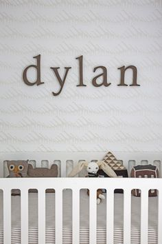 Name over crib - what a fab modern nursery!