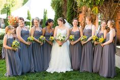 Yellow and gray bridesmaid dresses and flowers