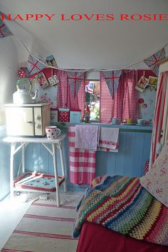 COOKING AREA inside holivan (camper?); love the cheerfulness layered on white & blue