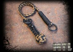 Paracord Self  Defense Lanyard ( known as monkey fist) featuring steel ball and metal skull bead w/ welded rings
