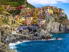 """These five seaside towns—the UNESCO World Heritage """"Cinque Terre""""—took a beating during the 2011 mudslides. But the Italian spirit is alive and well along this charming 10-mile stretch of coastline—the villages have rebounded, the walking path connecting them has been restored, and the hunt for the best spaghetti alle vongole enjoyed al fresco is back on."""