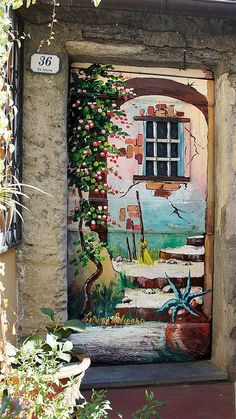 A hand painted door in Valloria, Italy, a small city where artists have painted all the residential doors into unique and beautiful works of art!