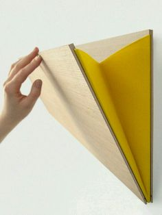 Unobtrusive and easily mounted, theLeaning Wall Pocket, a simple but sturdy storage pouch, is made in Belgium from plywood and comes in 12 different colors of felt