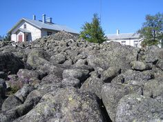 Stone pile in Tankar lighthouse island, Kokkola, Finland. According to a custom, every first-time visitor on the island must bear one stone from the seashore to the stone pile in the middle of the island.