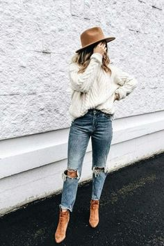 fall style with ivory sweater, ripped jeans and brown leather boots