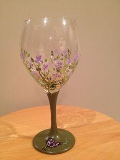 Flowers all around wine glass