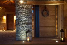 Cool front entry- uplighting on the stone, large wood and steel door
