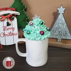Faux Whipped Cream Mug Topper featuring a Christmas Tree with a Silver Star and pink, green, blue ornaments. Perfect to display on your Coffee bar, Rae Dunn Mug Collection, or to use as a photography prop! *For display purposes only, not food safe.*