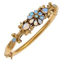 A beautiful jelly opal yellow gold bangle bracelet. The opals display very nice blue, green, orange and reds. The bracelet itself has a very easy to use hinge clasp. Gold Bangle Bracelet, Diamond Bracelets, Gold Bangles, Silver Bracelets, Jewelry Bracelets, Opal Jewelry, Luxury Jewelry, Silver Jewelry, Vintage Jewelry
