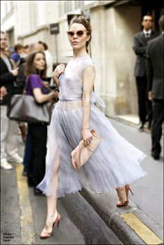 The lavender dress is nice, but it's all about the attitude.  Work it baby!