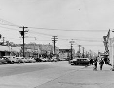 Reseda Boulevard looking north, one block south of Sherman Way, circa 1954. California Bank building is on southwest corner of Reseda Boulevard and Sherman Way and is still standing today. American flag on right is above Reseda Post Office. Gas pumps in lower right belong to Atlantic Richfield gas station. San Fernando Valley History Digital Library.