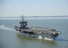 The aircraft carrier USS Enterprise (CVN 65) departs Naval Station Norfolk on its final deployment.