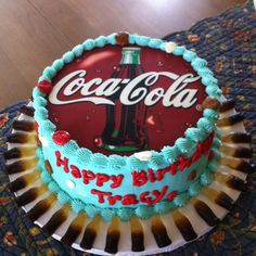 Coca Cola edible cake topper and candy coke bottles trim the board.