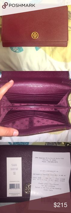Tory Butch Clutch Purse Authentic Tory Butch Purse that can also be used as a wallet! Includes detachable strap; beautiful maroon color. Has 16 card slots; used only a few times, so practically brand new. Tory Burch Bags Clutches & Wristlets