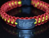 Paracord Dog Collar with engraved Dog Tag. $30.00, via Etsy.