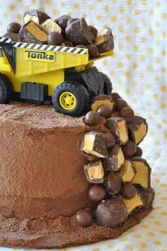"Tonka Truck Cake-bake whichever flavor of cake you want, then frost with chocolate icing.  Then dust a layer of cocoa powder all over the cake. Place a toy dump truck on top, then fill with malted milk balls and other chocolate candies. ""Spill"" the candies over the side of the cake too!"