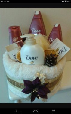6f6280fb62f66 glue cardboard onto a circular base   wrapped with a handtowel secured with  pins. Fill with dove products   add festive touches. Themed Gift BasketsRaffle  ...