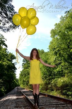 Senior session or sweet sixteen idea. I like the color of the balloons matching the dress.