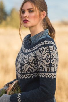 Color work yoked sweater knitting pattern. Mount Lorne Pullover by Andrea Cull knit in The Fibre Co. Cumbria.The Mount Lorne Pullover is a feminine take on unisex circular yoke sweaters featuring a bold, captivating graphic motif in two colors. You'll love knitting this seamless sweater from the pages of Interweave Knits, Winter 2018!