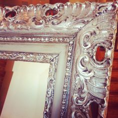 Vintage frame painted in pale Paris grey by Annie Sloan Chalk Paint with dark wax finish and silver gilding wax accents.