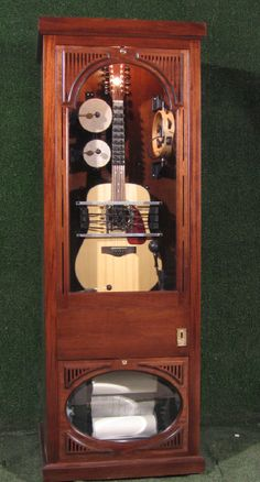 automated 12 String guitar in cabinet jukebox  Roll controlled