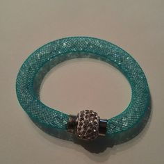 Blue mesh crystal filled bracelet Blue mesh crystal filled bracelet with rhinestones and a magnetic closure. Jewelry Bracelets