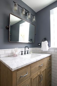 Starting a bathroom or kitchen renovation? Here are 5 things to know going into your first big home improvement project. Plus, a gorgeous before and after of this master bathroom complete with marble floor tile, subway tile, and a large wood vanity. #bathroom #bathroomdesign #homeimprovement #homerenovation Bathroom Renos, Vanity Bathroom, Master Bathroom, Bathrooms, Basement Bathroom, Eclectic Bathroom, Modern Bathroom, Diy Playbook, Wood Vanity